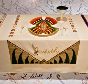 Judy Chicago, The Dinner Party: the place setting for 'Judith'. Note the vulva-shaped plate and the sword that forms part of Judith's name.