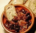 Bread and olives with a lamb stew