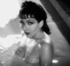 Claudette Colbert in a milk bath in the movie 'Cleopatra'