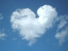 Heart-shaped cloud in a blue sky