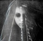 Veiled woman with downcast eyes