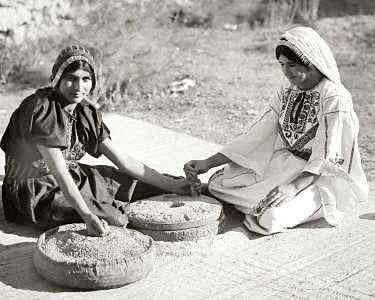 Women grinding grain