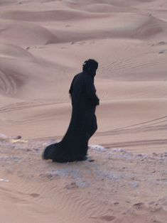 Middle Eastern woman alone in the desert
