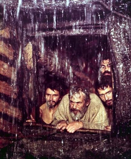 Bible movies, films. Noah and his sons peer out from the Ark in 'The Bible'