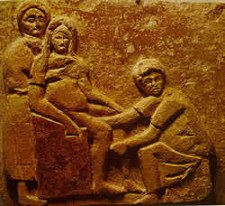 Childbirth in ancient times: Woman giving birth on a birthing chair, Roman era