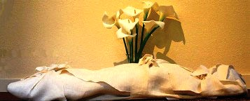 Body in a shroud, with lilies