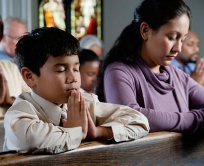 Meditation for Parents: A boy and his mother pray in church