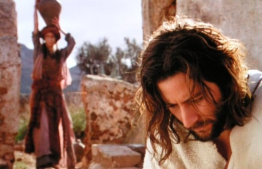 The Samaritan Woman approaches Jesus who is sitting at the well
