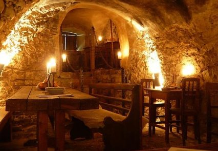 Interior of a tavern cut into the rock wall