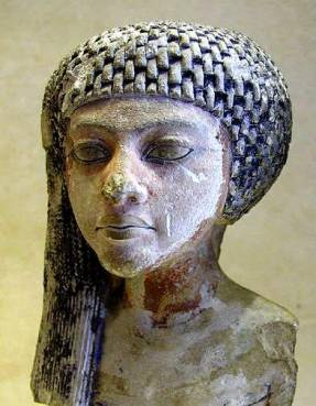 Statue of Queen Merit, discovered at Amarna. This shape of face was much admired at the time.