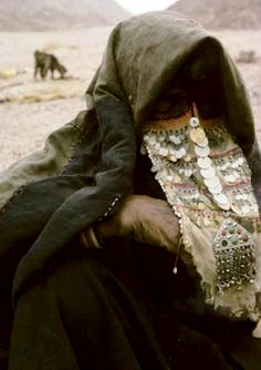 Money & Marriage: Bedouin girl wearing niqab with silver coins and jewelry