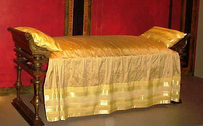 Reconstruction of an ancient, richly decorated bed