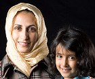 A Middle Eastern woman and her daughter