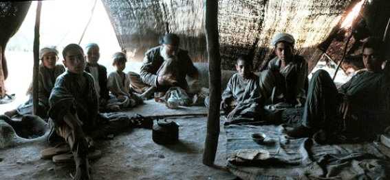 Interior of a tent with Middle Eastern tribal men
