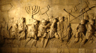 Masada: The Arch of Titus, showing victorious Roman troops carrying the Jerusalem menorah in triumphal procession