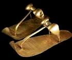 Facsimiles of gold leaf covered sandals, leather, from ancient Egypt; only for the very rich