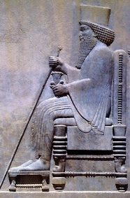 Ancient technology: stone carving of King Darius on his throne; notice the turned legs of the throne, which would have been carved with a lathe