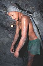 Young boy working in a mine
