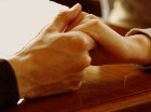 A man and a woman's hands clasped together