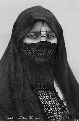 Women, work, worship: Photograph of a veiled Middle Eastern woman