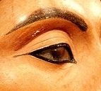 Close-up of the eye of Nefertiti, showing heavy, perfectly applied make-up