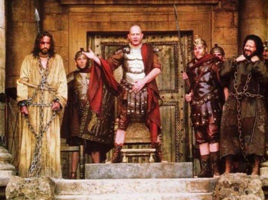 Pilate presents Jesus to the crowd, with Barabbas at right; still from the movie 'Passion of the Christ'