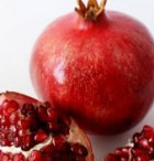 A ripe pomegranate with its multiple seeds