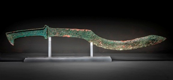 Canaanite sickle sword. This is the type of sword Eglon's guards would have expected Ehud to carry.
