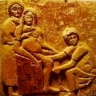 Woman using a birthing chair, ancient clay impression