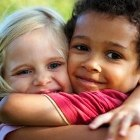 Two children hugging