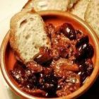 Bowl of stew, olives, bread