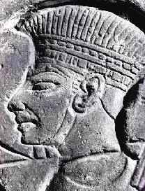 Wall relief of a defeated Philistine warrior