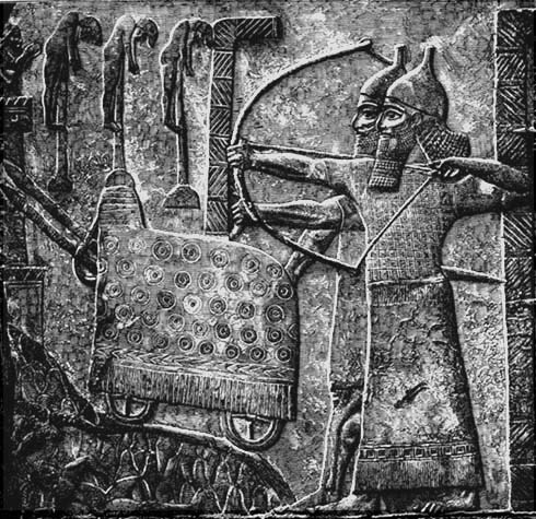 Assyrian wall relief, showing impaled captives (upper left)