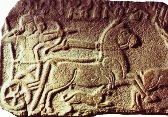 Assyrian chariot with archer, stone wall relief