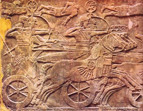 King Ashurnasirpal leads a charge against the infantry and chariots of the enemy